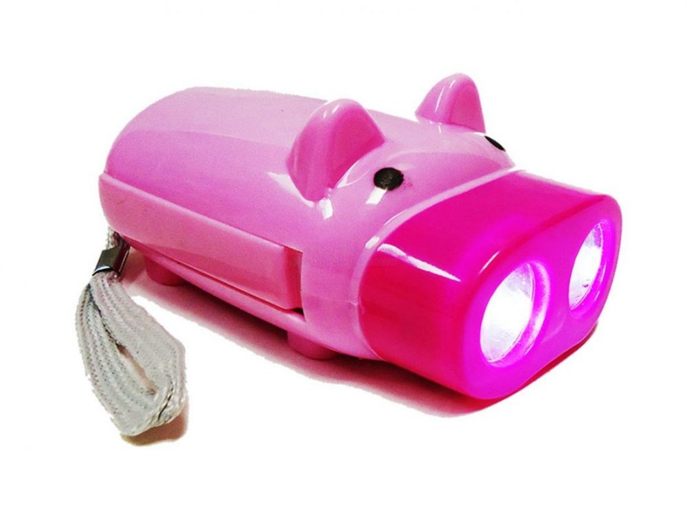 light led piggy flashlight with light on.a